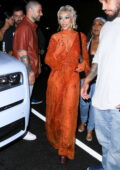 Doja Cat looks striking in orange while attending a birthday party at The Highlight Room in Hollywood, California
