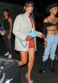 Dua Lipa looks fab in an orange playsuit with a grey blazer during a night out at Delilah in West Hollywood, California