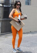 Eiza Gonzalez looks fit in orange workout top and leggings while leaving a workout session in West Hollywood, California