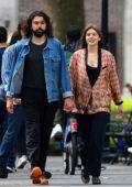 Elizabeth Olsen and Robbie Arnett hold hands as they enjoy a leisurely stroll in New York City