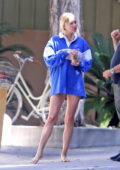 Elsa Hosk flaunts her legs as she steps out barefoot while chatting with a construction worker outside of her home in Los Angeles