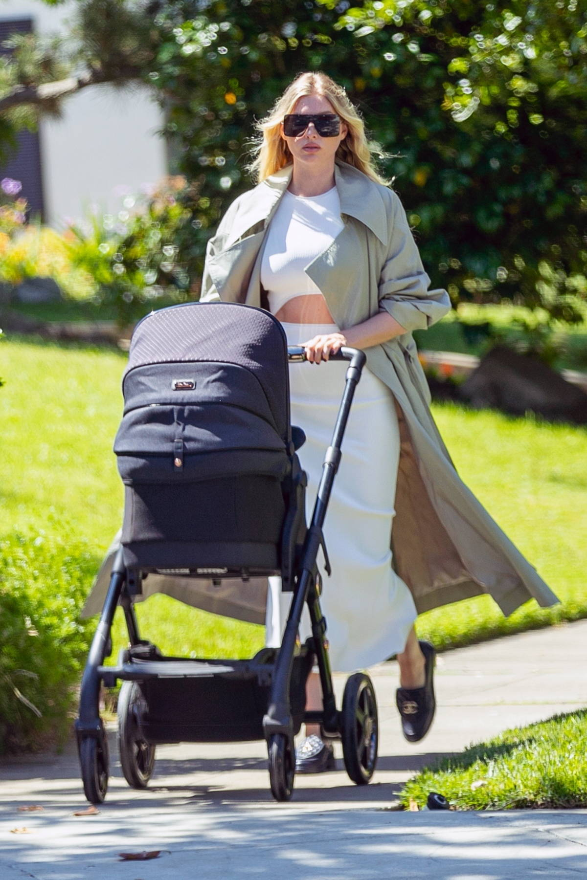Elsa Hosk looks chic in a light green trench coat while out for a stroll with her baby in Pasadena, California