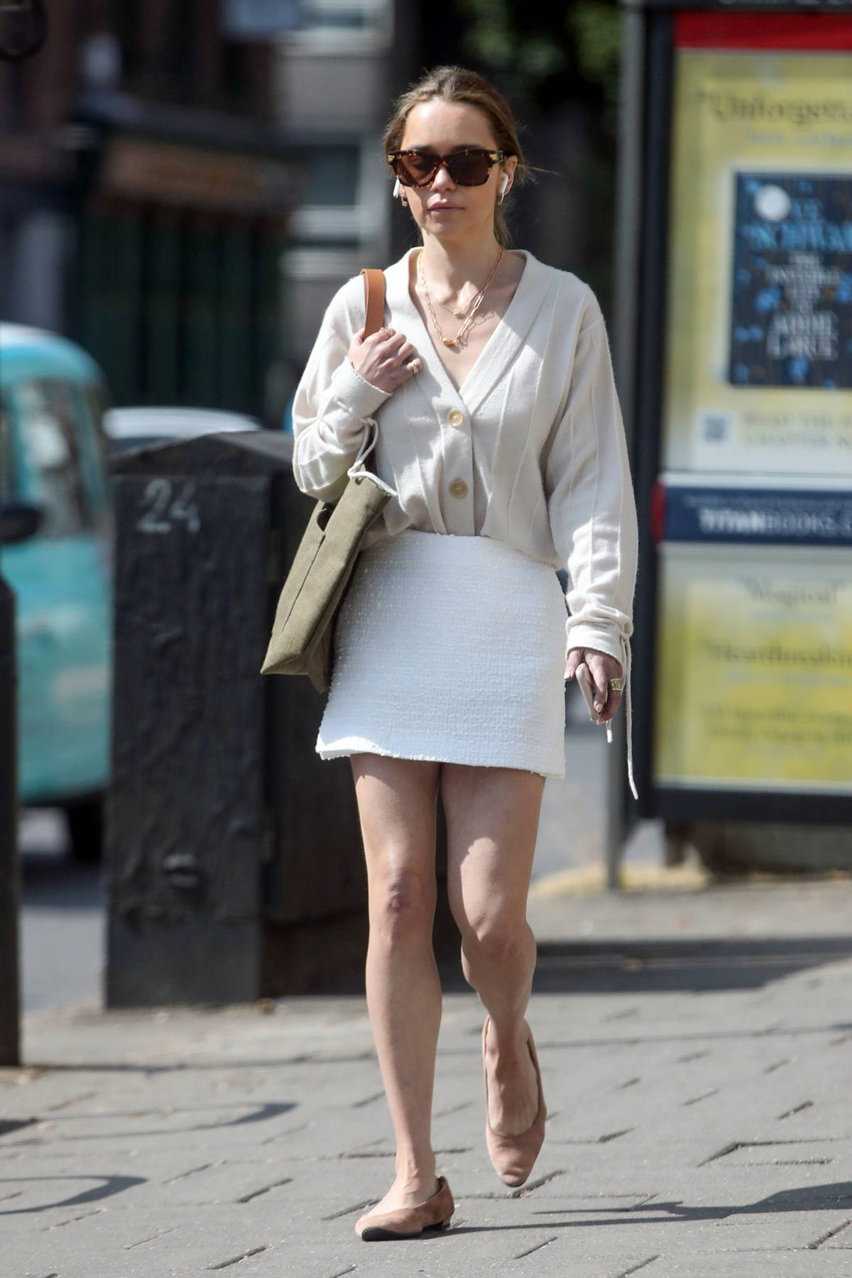 Emilia Clarke gets leggy in a white mini skirt while out for some shopping in London, UK