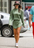 Emily Ratajkowski displays her legs in a short olive green ensemble while out for a stroll with her husband in New York City