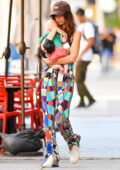 Emily Ratajkowski dons a colorful outfit while heading out with her son and husband in New York City