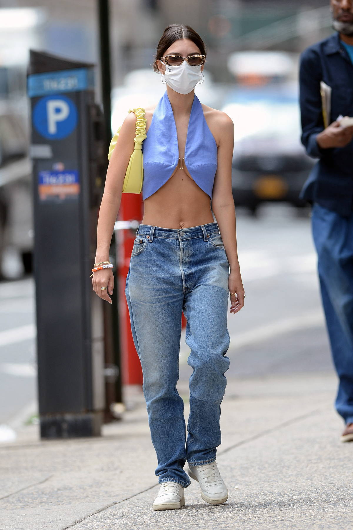 Emily Ratajkowski flashes her washboard abs while out with her husband in New York City