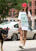 Emily Ratajkowski keeps things casual with an oversized t-shirt and legging while walking her dog in New York City