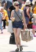 Emma Roberts dons denim shorts and a striped top while shopping for vintage clothing in Copley Square, Boston, Massachusetts