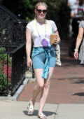 Emma Roberts gets leggy in lycra shorts and a white tee while out on a coffee run in Boston, Massachusetts