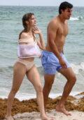 Eugenie Bouchard wears a beige bikini and an arm sling during a beach day with boyfriend Mason Rudolph in Miami, Florida