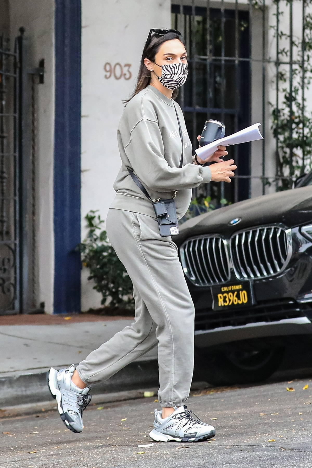 Gal Gadot stays cozy in a grey sweatsuit during a trip to Nine Zero One Salon in Beverly Hills, California