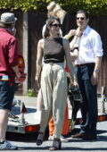 Gemma Arterton is all smiles while filming scenes for 'Freegard' in London, UK