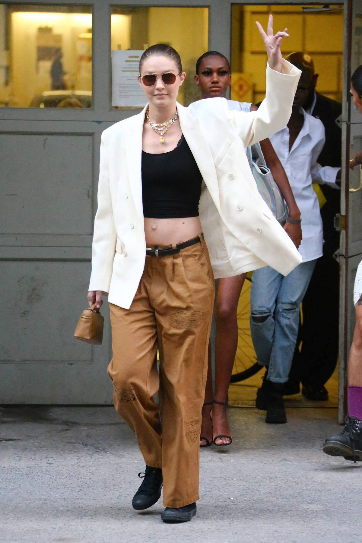 Gigi Hadid flashes her midriff as she leaves the Marc Jacobs Fashion show at the public Library in New York City