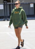 Hailey Bieber sports a green Drew hoodie with matching shorts as arrives at XIV Karats store in Beverly Hills, California