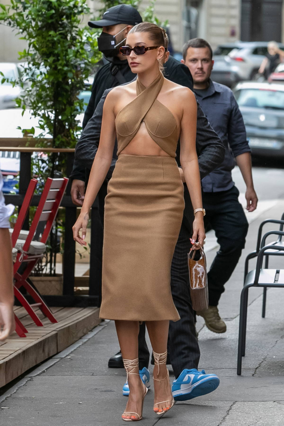 Hailey Bieber stuns in a backless brown dress while out with Justin Bieber at Dinand by Ferdi restaurant in Paris, France