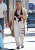 Hilary Duff is all smiles as she steps for shopping with her family in Los Angeles