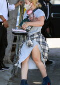 Hilary Duff seen carrying some food and books as she arrives at a hair salon in Los Angeles