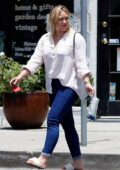 Hilary Duff wears a light pink shirt and blue skin-tight jeans while running a few errands in Los Angeles