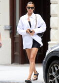 Irina Shayk flashes her legs in a black mini dress underneath an oversized white shirt while out with her daughter in New York City