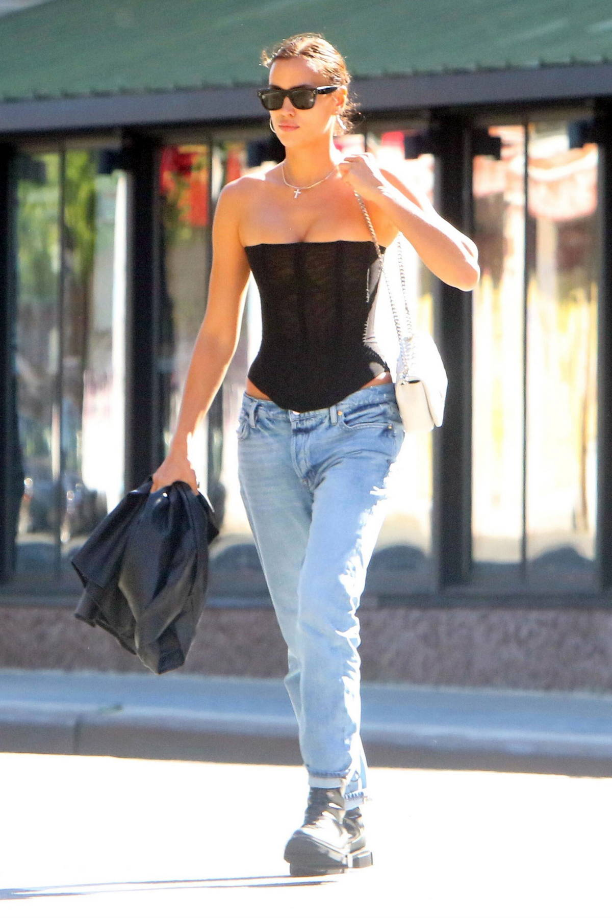 Irina Shayk steps out in a laced bodysuit paired with jeans and a leather jacket in New York City