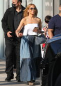 Jennifer Lopez dons denim maxi skirt and white crop top while out shopping with her son at Ralph Lauren in Beverly Hills, California