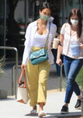 Jessica Alba heads to the Honest Headquarters rocking soft pastel colors in Los Angeles