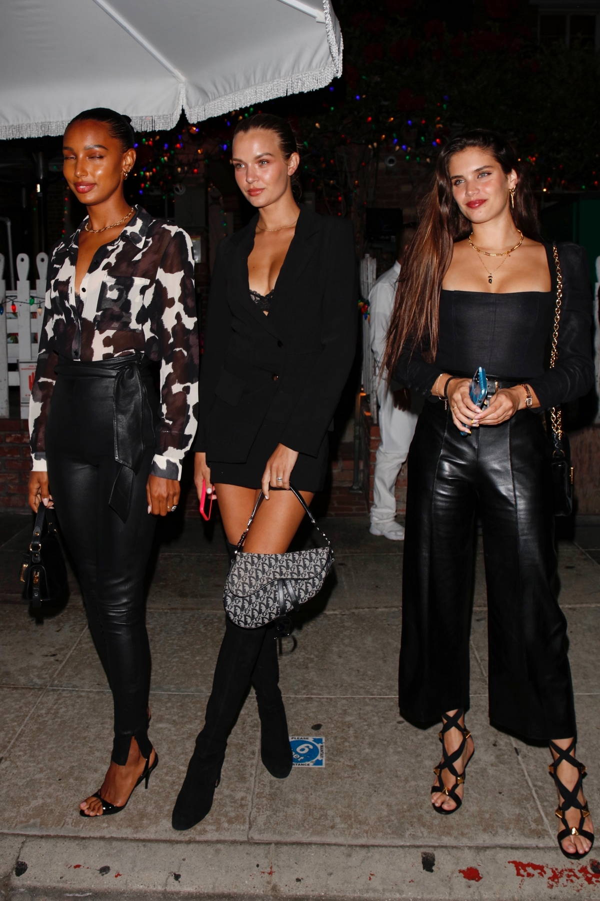Josephine Skriver, Jasmine Tookes, and Sara Sampaio enjoy a girls night out at the Ivy in West Hollywood, California