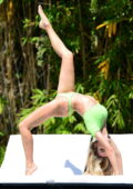 Joy Corrigan showcases her flexible body in a green swimsuit during a photoshoot at the Alo house in Los Angeles