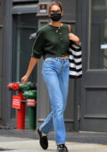 Kaia Gerber keeps it casual yet stylish with a green cropped cardigan and blue jeans as she steps out in New York City
