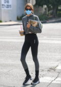 Kaia Gerber picks up coffee and grabs a handful of magazines after her morning workout in West Hollywood, California