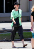 Kaley Cuoco keeps it casual in a green t-shirt and black joggers while running a few errands after yoga class in Los Angeles