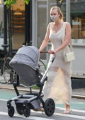 Karlie Kloss looks amazing in an off-white crochet dress as she takes her baby out for a stroll in New York City
