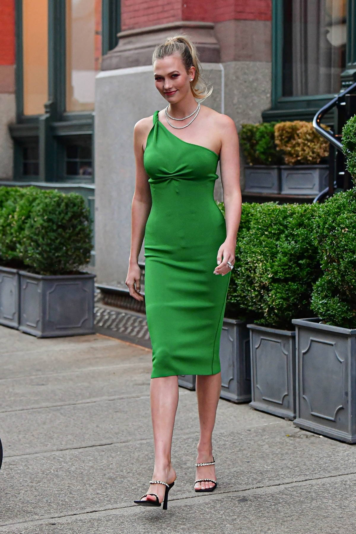Karlie Kloss looks stunning in a green dress as she steps out for the evening in Brooklyn, New York