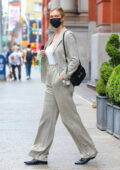 Karlie Kloss wears a stylish woven blazer with matching trousers while out for a stroll in Soho, New York City