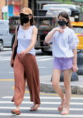 Katie Holmes and Suri Cruise walk home after stopping at Maria Tash in Soho in New York City