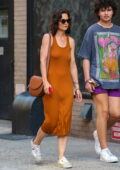 Katie Holmes seen wearing a burnt orange dress while out in New York City