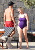 Katy Perry looks great in a purple swimsuit while enjoying a beach day with Orlando Bloom in Peloponnese, Greece
