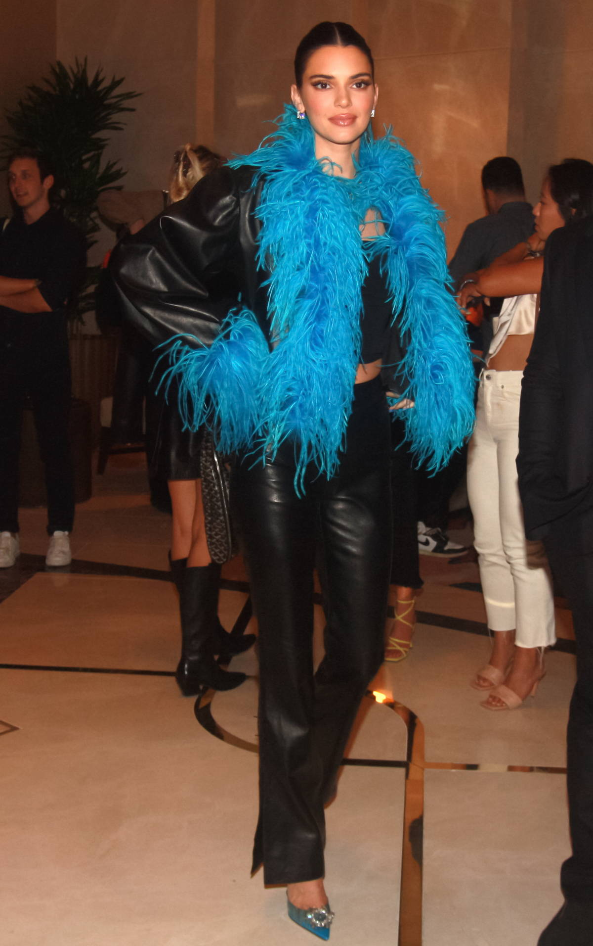 Kendall Jenner rocks a blue feather boa with a black top and leather pants while heading for a night out in Las Vegas, Nevada