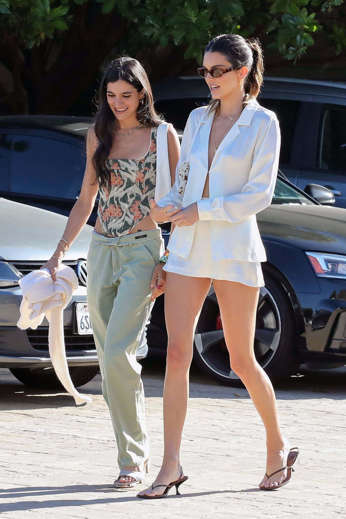 Kendall Jenner shows off her supermodel legs in a white mini skirt while out for lunch with friends in Malibu, California