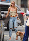 Kimberley Garner shows off her toned figure in a beige corset while enjoying drinks with friends in Chelsea, London, UK