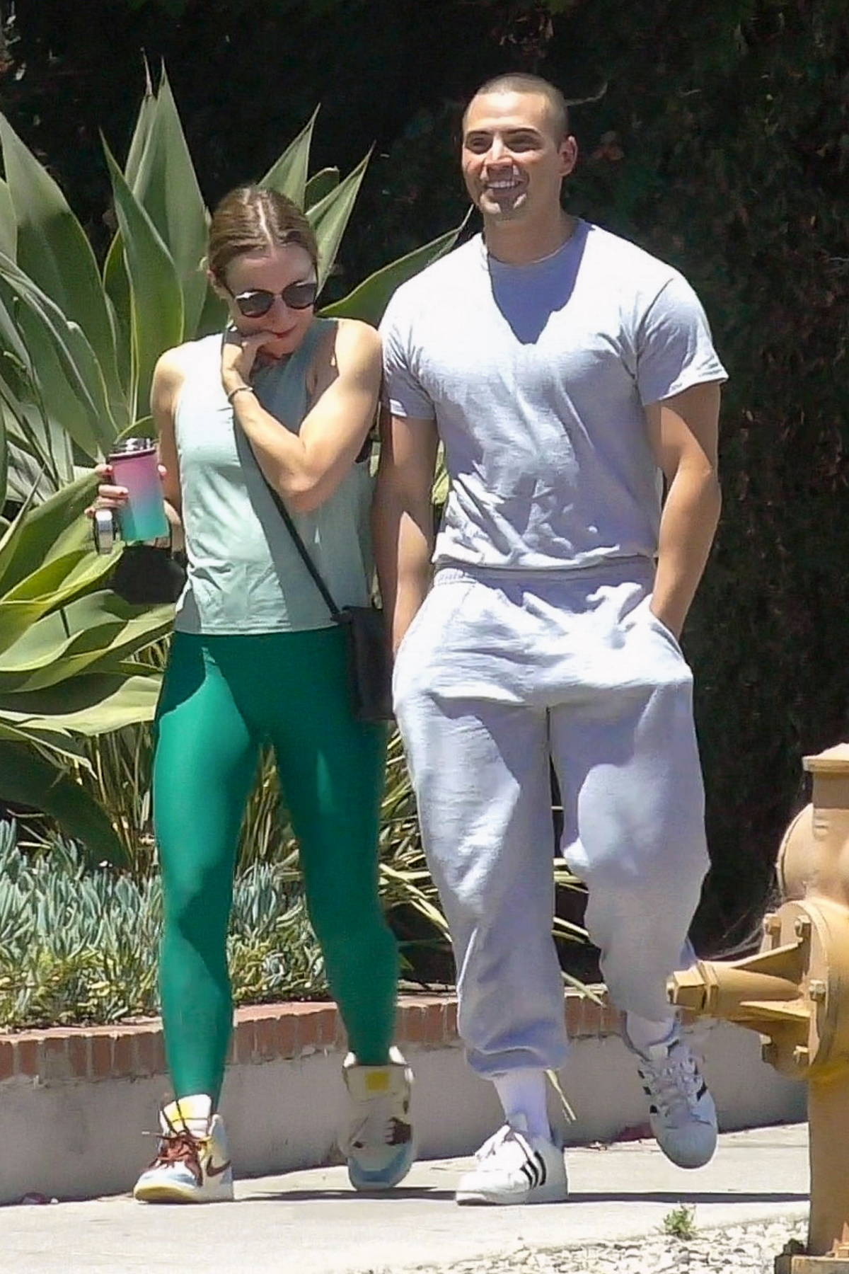 Kristen Bell sports green leggings and a mint-green top as she leaves the gym with Benjamin Levy Aguilar in Los Feliz, California