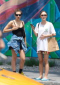 Lily-Rose Depp hails a cab after shopping with a friend around Manhattan's East Village, New York City