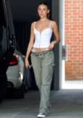 Madison Beer looks trendy in a white corset top and baggy jeans as she leaves a studio in West Hollywood, California