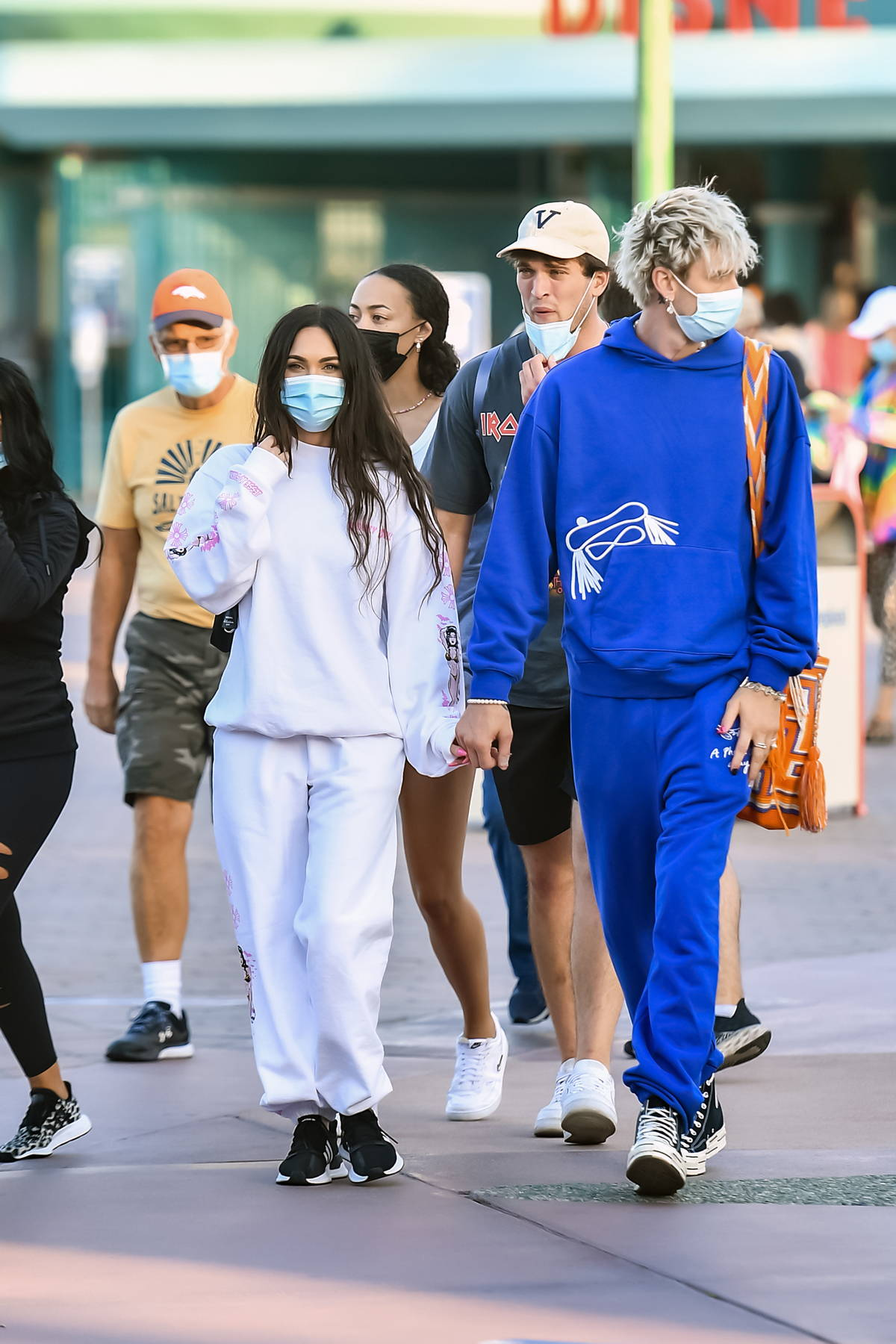 Megan Fox and Machine Gun Kelly enjoy a day out with friends and family at Disneyland in Anaheim, California