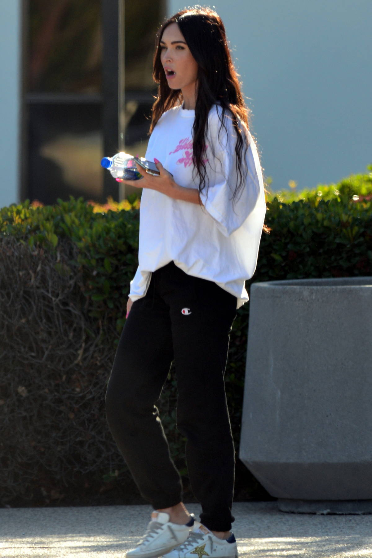 Megan Fox keeps it casual in an oversized tee and sweatpants while out with Machine Gun Kelly in Los Angeles