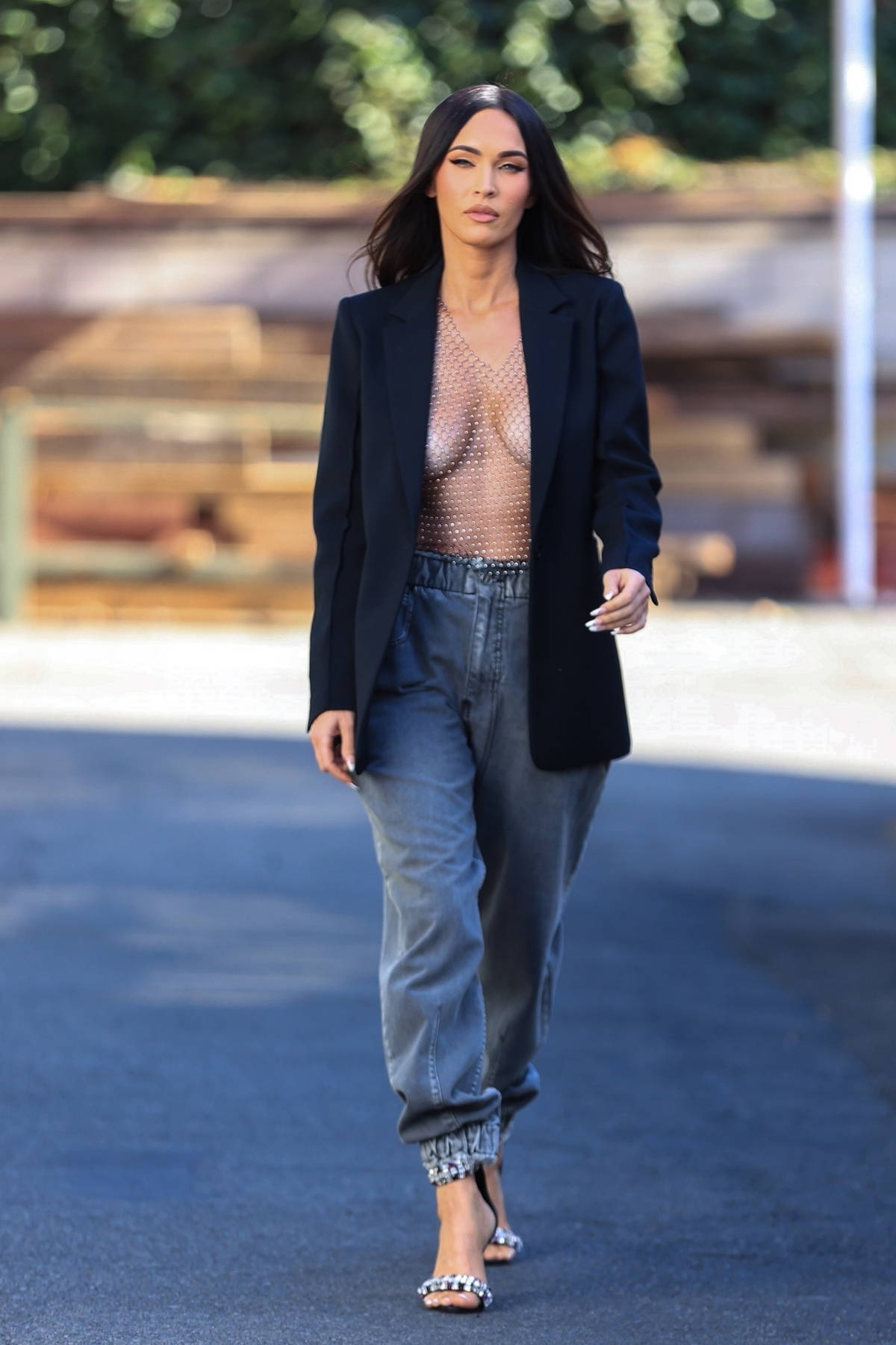Megan Fox looks sensational in a mesh top with a black blazer while leaving a photoshoot in Los Angeles