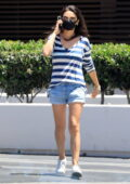 Mila Kunis keeps it casual in a striped top and denim shorts while out in Beverly Hills, California