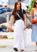 Minka Kelly looks radiant in a flowing white skirt and a black top while out running errands with a friend in New York City