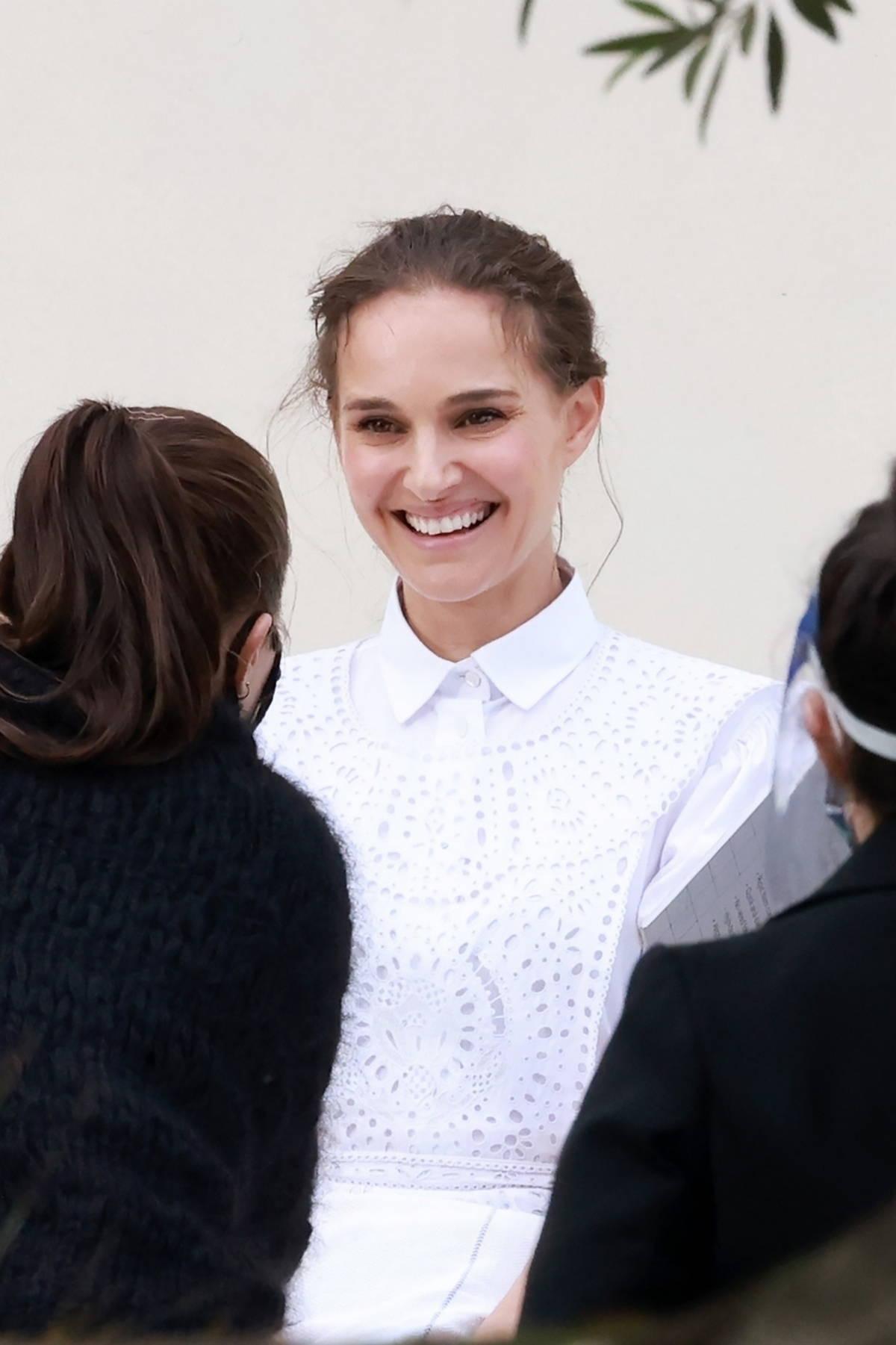 Natalie Portman seen wearing a white doily dress during a photoshoot in Sydney, Australia