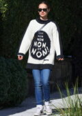 Natalie Portman wears an oversized J'aDior sweater as she steps out in Sydney, Australia